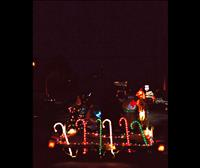 Small parade of lights travel through Arlee for eighth year in a row