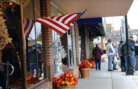 Shoppers patronize local stores along Polson's Main Street on Small Business Saturday.