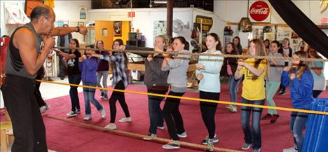 Retired pro boxer Ken Camel shows a group of Polson Middle School girls how to throw a jab Dec. 15 at the Montana Kids Co-op in Polson.