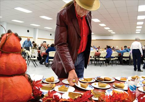 Bear Adams joins his wife and more than 400 other guests at the annual Ronan Community Thanksgiving Dinner.