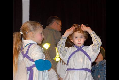 """Kaycee Wright, left, watches as Logan Smith adjusts his halo before dress rehearsal of """"The Best Christmas Pageant Ever."""""""