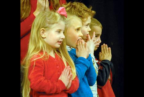 Little angels Gracie Larivee, left, Kaycee Wright, Logan Smith and Kyle Alexander line up for the grand finale.