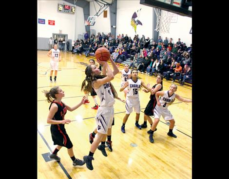 Kent Luetzen/Valley Journal Cheyagy flies to the hoop as her teammates box out their opponents.