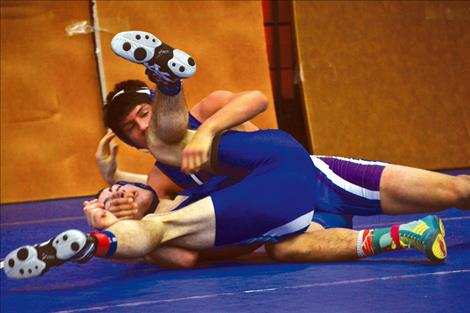 Bulldog Trent Dennison pins Derek Neel of Townsend in just 1:41 on Friday during round one of the Ronan Duals.