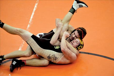 Ronan Chief Kail Cheff pins Stevensville's Mason Griffin in 3 minutes during round one of the 182-pound weight class.