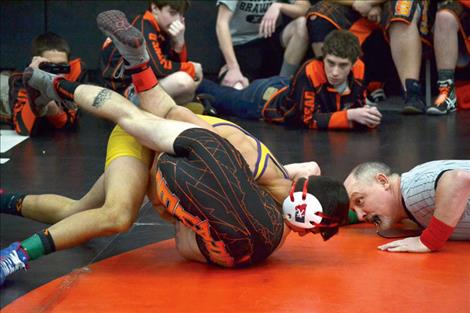 Bridger Wenzel of Polson pins Cody Moats of Flathead JV in :48 seconds.