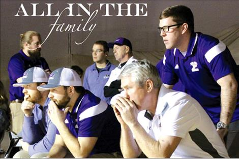 Five Owen men exhibit the family's intense love for the sport of wrestling as they sit together watching a match.