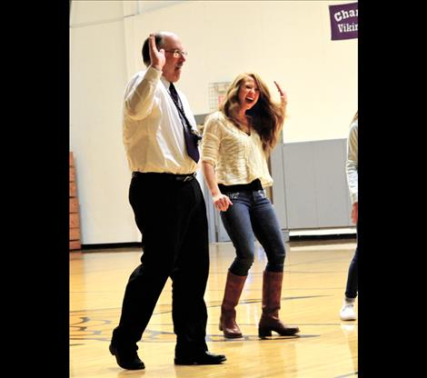 """History teacher Bret Thompson learns to """"whip and  nae-nae""""  with  students, which is a popular new dance move."""