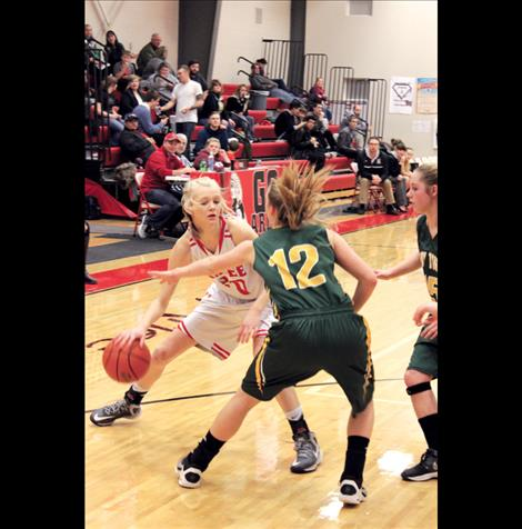 Arlee's Lady Scarlet Carly Hergett scored nine points in the winning game against St. Regis last Thursday.
