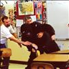 Teacher Lyle Cronk and Principal Dan Durglo practice taking down a mock intruder provided by Lake County Sheriff's Office.