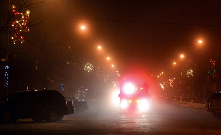 Ronan police and fire personnel escort Tomy Parker along a foggy Main Street as Parker returned home last week.