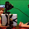 Kenna Ferril and Gabe Moxness record a segment for the school news.