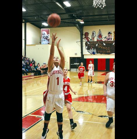 Casadi Wunderlich puts up a shot during a recent game against the Arlee Scarlets.