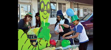 Library patrons decorate their parade float.