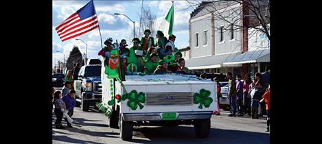 Folks wear green of all sorts for the St. Patrick's Day parade.