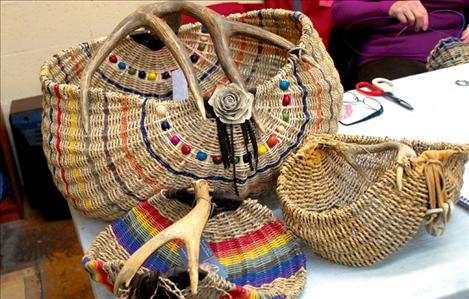 Brigitte Miller's baskets brighten up the back room of the Sandpiper Art Gallery during the art walk. Miller was demonstrating her basketry, and she also teaches classes.