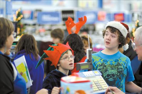 St. Ignatius Middle School students spend money they raised on craft and wreath sales to purchase items for Share the Spirit.