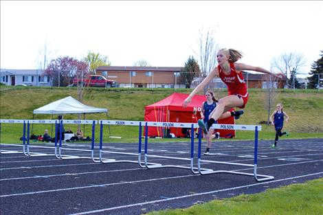Arlee Scarlet Carlee Hergett leaps  a hurdle duing an earlier meet. Hergett placed second in both  the 100 hurdles and long jump at divisionals