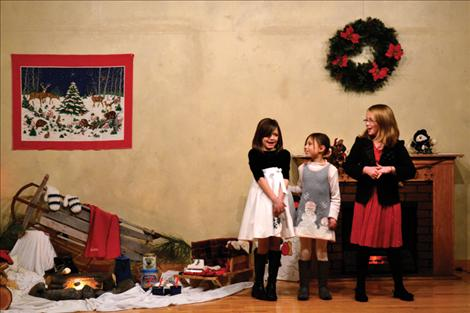 "Rylie Lindquist, Kylee Niemeyer and Hannah Rowe, from left, perform ""Jingle Bells"" Dec. 10 at the North Crow Clubhouse Christmas party."