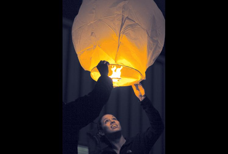 "Ashleigh Lynch sends a Chinese lantern into the night sky last Wednesday night as many of her classmates and fellow residents followed suit. Ronan High School teacher Bonnie Eva said the event was planned and organized in part by Ronan High School's student council.  ""It's a remembrance for anybody you couldn't see over the holidays,"" Eva said. ""Whether they've passed away; just couldn't be here; are on active duty service overseas or they're just many miles away."" Ronan resident Emosi Tatukivei and daughter Adriana were on their way home when they saw the lanterns floating toward the mountains over U.S. Highway 93. Emosi said he first thought they were helicopters.  ""This is really cool,"" he said. ""What a great way to celebrate."""