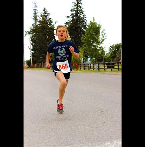 Megan Evelo, 12, finishes the 4-H Fun Run in first place.