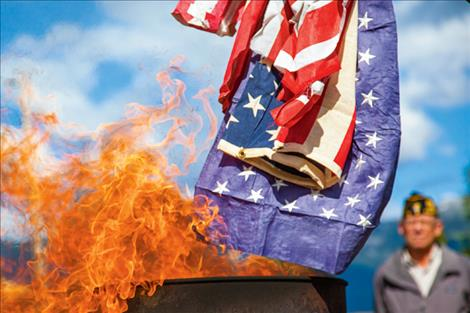 Tattered stars, stripes retired by fire