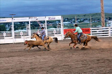 Jimmy Racine and Pete White compete in team roping.