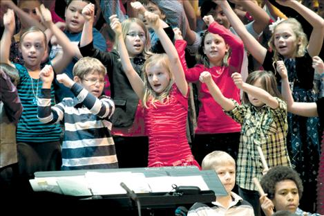 "K. William Harvey Elementary students (front row, left to right) Tristen Mayfair, Girma Detwiler; (second row, left to right) Jasen Rodda, Chella Fuchs, Rylie Lindquist; (third row left to right) Isabela Larios, Hannah Rowe, Emma Lloyd and Haylie Webster dance to ""Don't Eat a Poinsettia"" during the school's Christmas concerts Dec. 14"