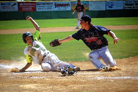 Mariner Bryant Hales slides into home during the championship game against Livingston.