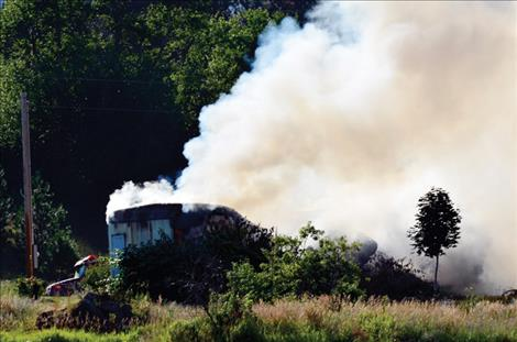 A trailer home in St. Ignatius burns Wednesday morning, July 20.