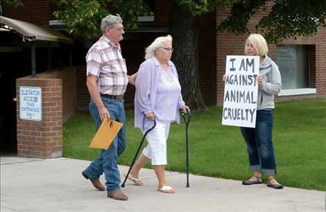Puppy mill owners appear in court amid demonstrators