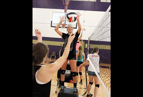 Lady Pirate Paige Noyes practice hitting the volleyball.