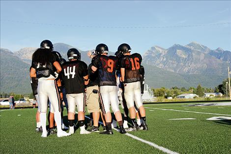 Ronan football teammates created some good unity during their two-a-day workout schedule and are now ready to put their teamwork to use on the field.