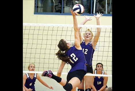 Charlo Lady Viking Cheyenne Nagy leaps to score a kill against Sheridan Lady Panther Janie Smart during Saturday's Western C opening tournament in Drummond. The Vikings came in second place against 15 other teams, losing to Valley Christian in the championship game.