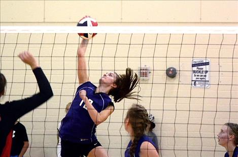Cheyenne Nagy goes up for the kill in Drummond.