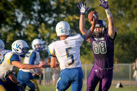 Charlo senior Kane Shenyer goes up to block a Pirate pass.