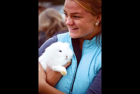 Devi Knutson holds one of the Saddle Mountain 4-H bunnies at the petting zoo