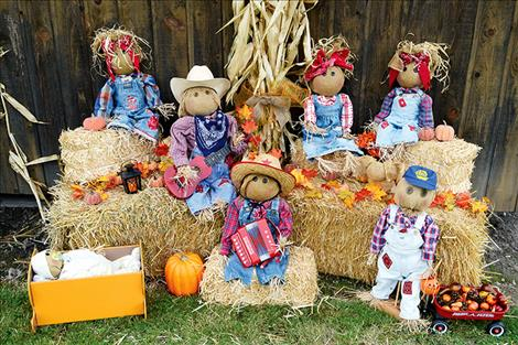 a family band of hay-stuffed folks created by Holly Lockwood take the prize in the scarecrow decorating contest.