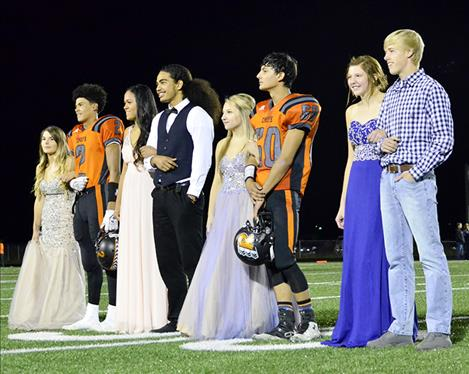 Ronan homecoming royalty await the crowning of Queen Rhylee Burland and King Tyler Houle, second couple from the right, during halftime of Friday's 35-6 victory over Anaconda.