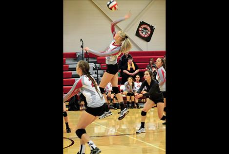 Carly Hergett leaps for one of her six kills against Plains on Sept. 20.