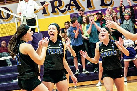 Lady Pirates celebrate a point during Saturday's match against Dillon.