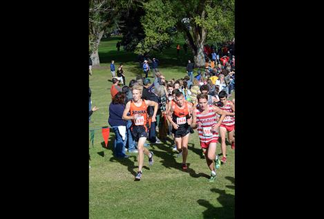 Jackson Duffey of Ronan High School roars up a hill before finishing in 49th place overall with the fastest time of any local runner.
