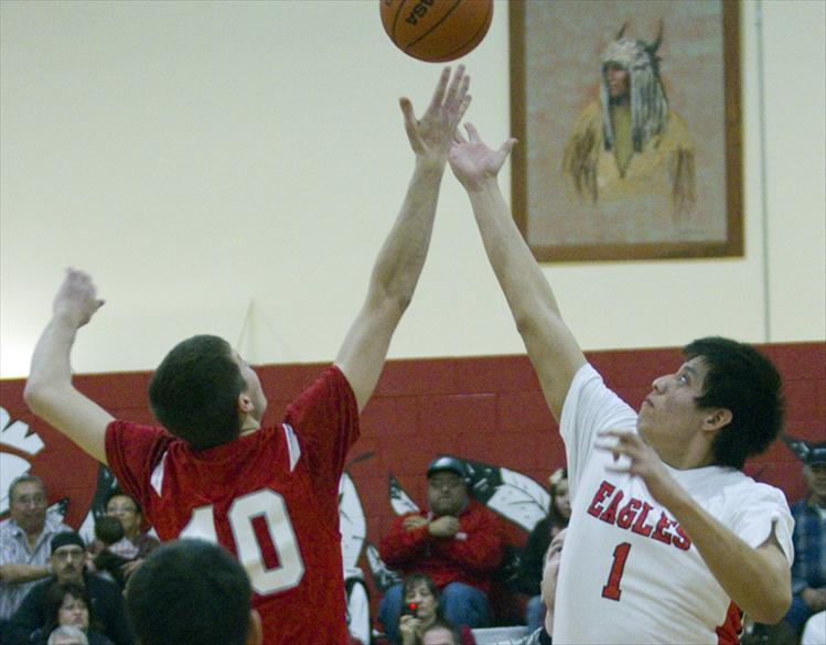 Blaine Leonard stretches to beat Arlee's Josh Reed at tip-off.