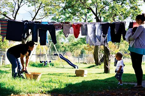 lie Lowther hangs laundry at The Nest. She is working on building a healthy life for her children with support from staff including Resident Advocate Amy Tall Bull.
