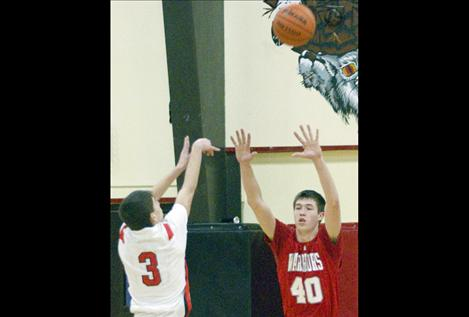 Josh Reed guards Two Eagle's Clayton Malatare.