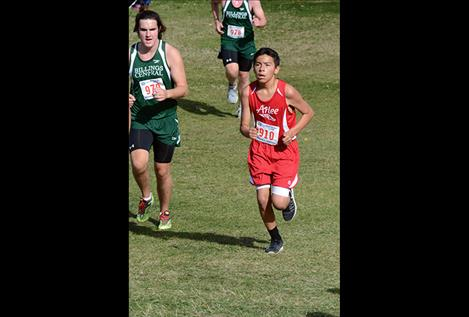 The Arlee Warriors finished in fourth place at Saturday's King Ranch Invitational 2-mile run. Left, Warrior James Crazyboy runs at the Mountain West meet in Missoula in September.