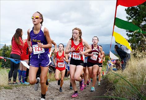 Lady Pirate Molly Sitter, running in Missoula, above, broke below the 20-minute barrier Saturday in Whitefish.