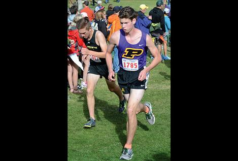 Polson's Matt Sitter (in Missoula, above) ran a sub-18- minute mile Saturday in Whitefish.