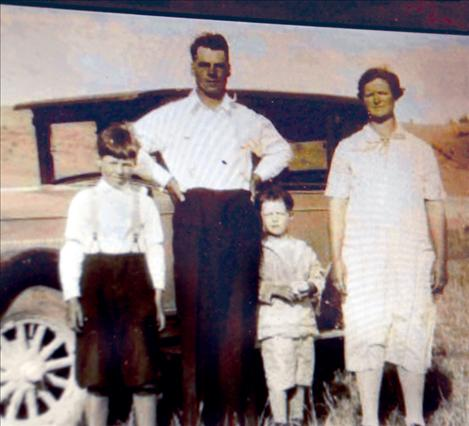 A vintage photo of Morris, left, and Orville, in the middle, with their parents Martin and Clara Bjorge is one of the highlights of the slide show at Orville's 90th birthday.