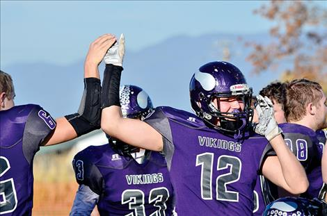 Brady Fryberger celebrates the Vikings' win after Saturday's game.